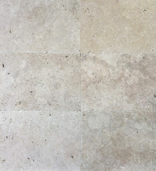 ivory travertine unfilled and tumbled pavers