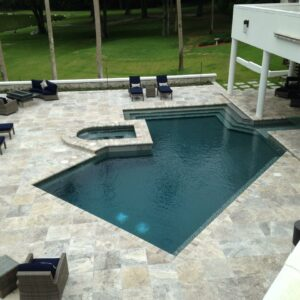 silver travertine pool pavers and coping unfilled and tumbled